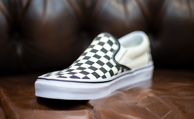 af6d37a1b73 This statement slip on shoe can be styled with some of your more simple  pieces of clothing to contrast the checkerboard pattern.