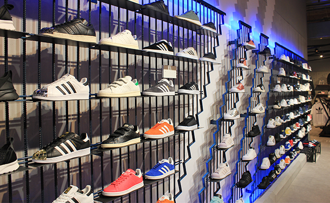 While there are plenty of clothing racks and shelves stacked with prime  merchandise, Adidas Originals is anchored by a design feature known as The  Wall.