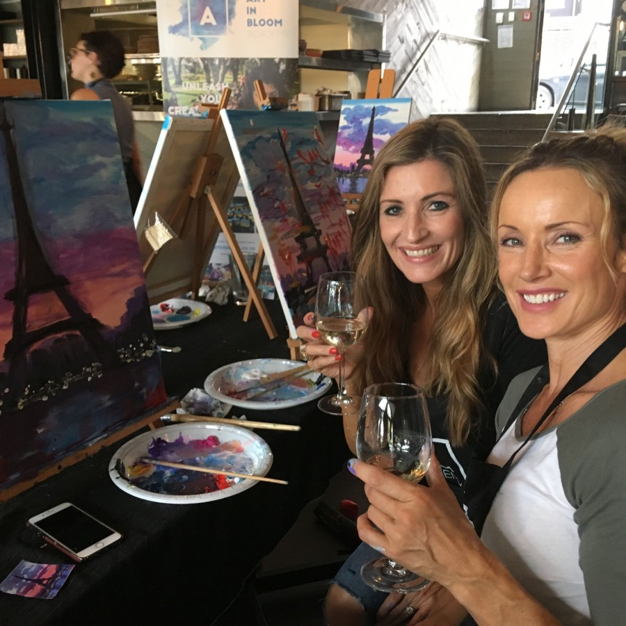 People drinking wine and painting