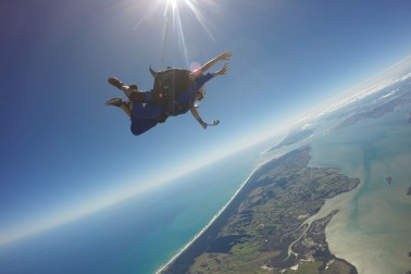 People skydiving