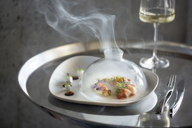 Dry Ice filtering out a dome of food