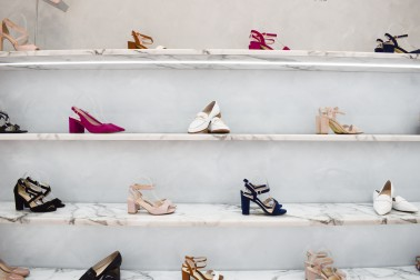 Shelf displaying womens shoes