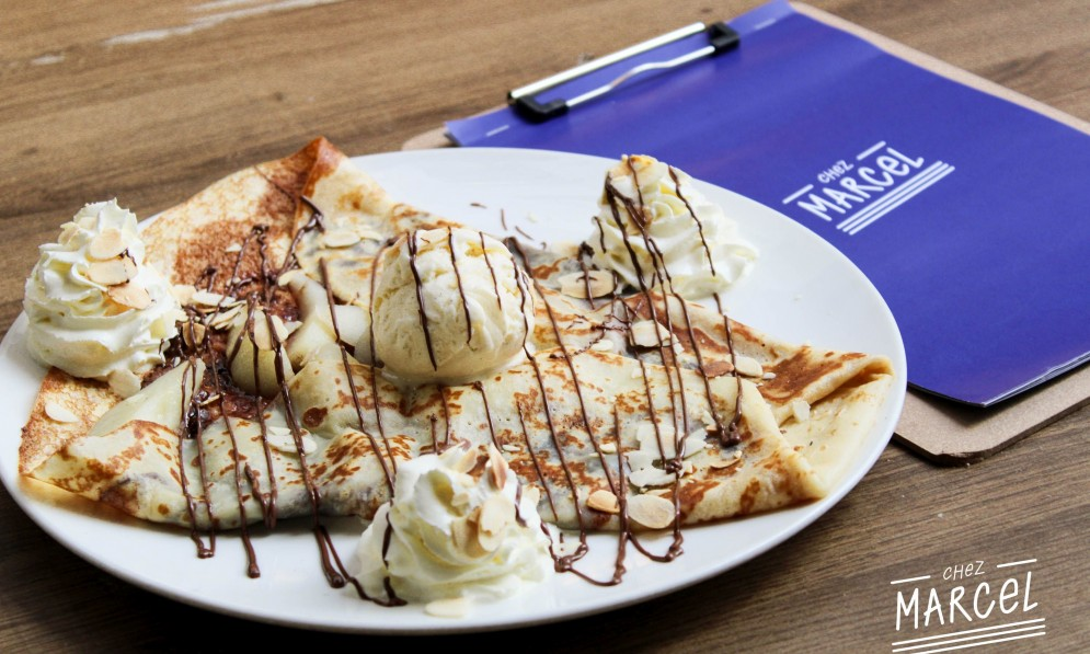 Ice cream and crepes with drizzled chocolate