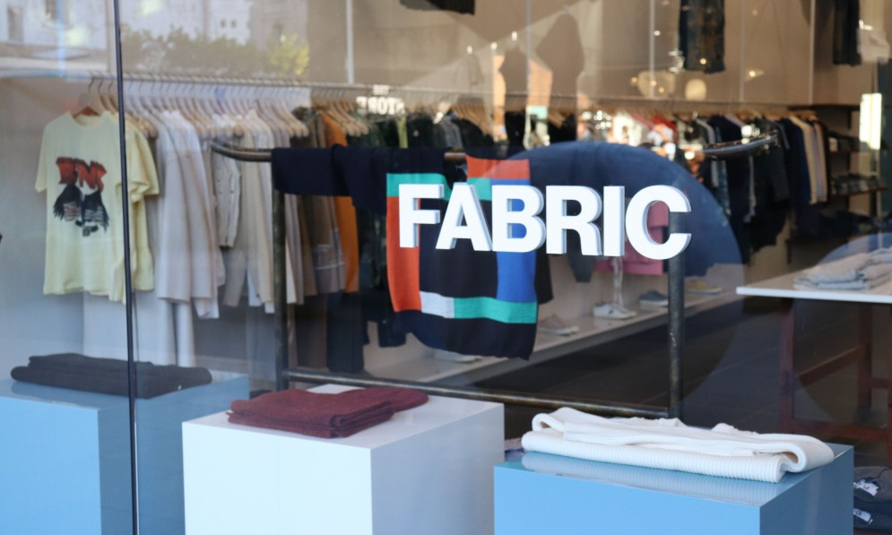 Fabric logo on outside of store