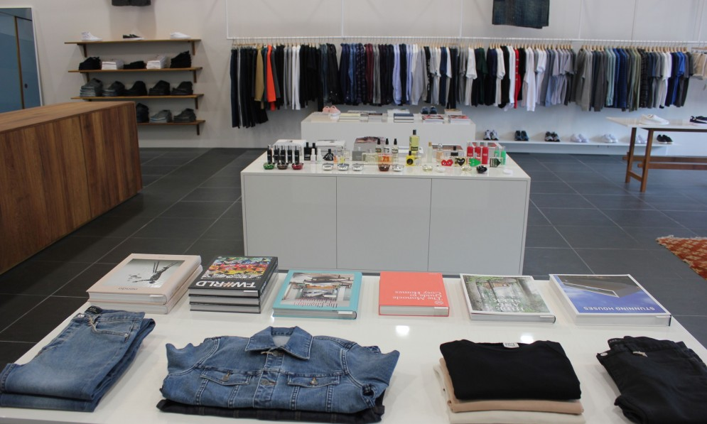 Garments, books and perfume displayed in the store