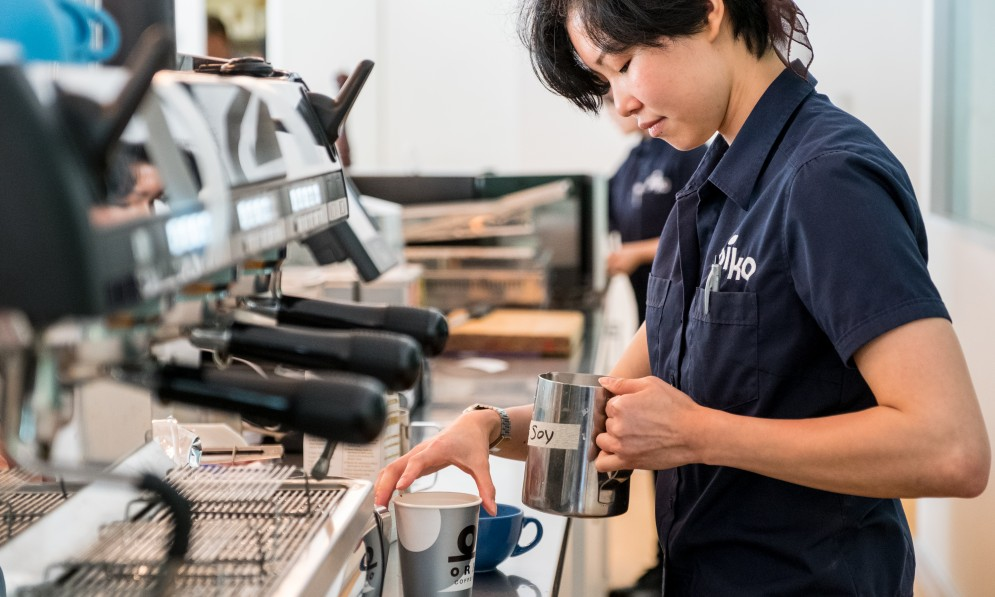 Barista making coffee