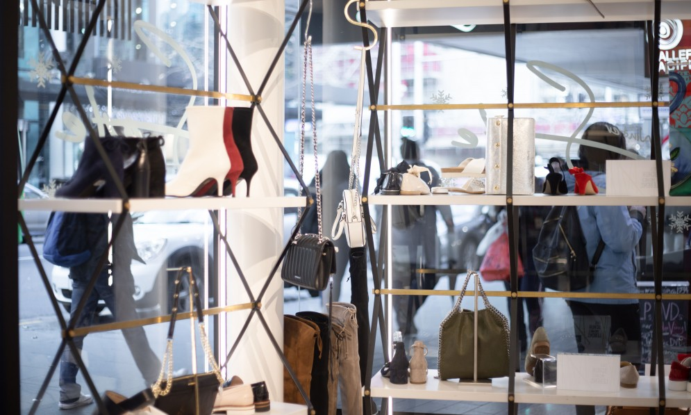 Bags and shoes displayed in window