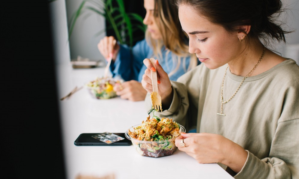 People eating poke bowl